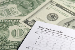 Planejador do ano em dólares Fotografia de Stock Royalty Free