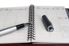 Planejador do dia & pena - 2 Fotografia de Stock Royalty Free