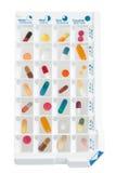 Planejador mensal dos comprimidos com uma dose diária das medicamentações em cada pilha Fotos de Stock