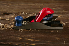 Planer carpenter hand tool wood shaving Royalty Free Stock Image
