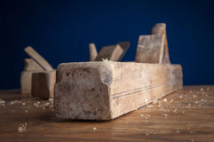 Planer carpenter on a wooden background Royalty Free Stock Images