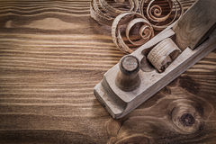 Planer planning chips on vintage wooden board construction conce Stock Photos