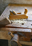 Planer shavings and sawdust in an antique wooden Workbench. Planer sawdust in an antique Workbench with vise Royalty Free Stock Images