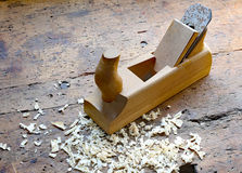 Planer shavings and sawdust in the Workbench. Inside the craftsman joinery manufacturer Royalty Free Stock Photo