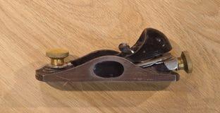 Planer sur la table en bois Photo libre de droits