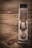 Planer on vintage wooden board construction concept Royalty Free Stock Photo