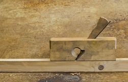 Planer on wood in rusty background Royalty Free Stock Images