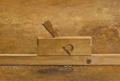 Planer on wood in rusty background Stock Image