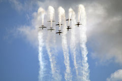 Planes, acrobatics. Plane performing acrobatics on the airshow event Royalty Free Stock Photo