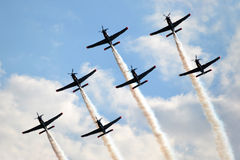 Planes, acrobatics. Plane performing acrobatics on the airshow event Stock Images