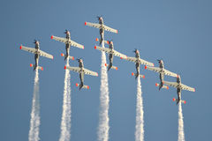 Planes, acrobatics. Plane performing acrobatics on the airshow event Stock Image