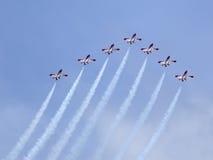 Planes on an air show against clear sky Stock Photos