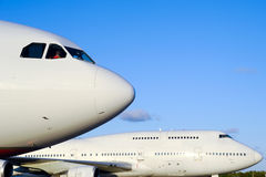 Planes in airport. Two jumbo jet planes in an airport royalty free stock image