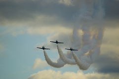 Planes on airshow. Pilots make their maneuver during the Air Show Royalty Free Stock Photo