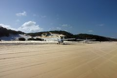 Planes on the beach. Couple of airplanes that landed on the beach (Fraser Island, Australia Royalty Free Stock Images