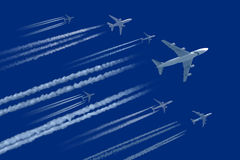 Planes on blue sky Stock Images