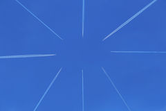 Planes in the blue sky flying towards each other Royalty Free Stock Photos