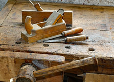 Planes and chisels in the Workbench with a wooden vise inside th Royalty Free Stock Images
