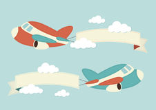 Planes in the clouds with banners. Illustration of planes in the clouds with blank banners Stock Photo