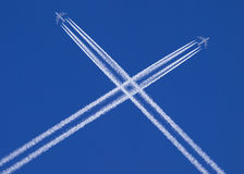 Planes that cross in the sky Stock Photography