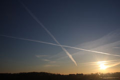 Planes Crossing. Two planes' routes cross each other drawing X letter on the sky Royalty Free Stock Photos