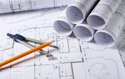 Planes de la arquitectura con el compás Fotos de archivo libres de regalías