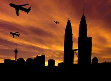 Planes departing Kuala Lumpur at sunset Royalty Free Stock Photography