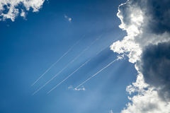Planes flying across the sky leaving a trail. Three aircraft flying in the blue sky, leaving a trail Stock Photography