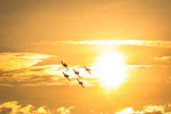 Planes flying in sun Royalty Free Stock Photos