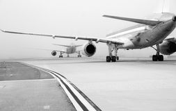 Planes on foggy runway royalty free stock images