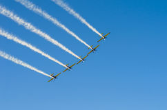 Planes in formation on sky. Planes flying in formation on a clear blue sky background at the Bucharest International Air Show (BIAS) on June 22, 2014 in Royalty Free Stock Photography