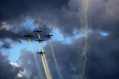 Planes group in acrobatic flight at an airshow stock images