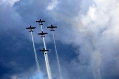 Planes group in acrobatic flight stock photos