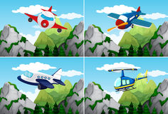 Planes and helicopter flying over the mountains Royalty Free Stock Photo