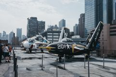 Planes and helicopters outside on the carrier in Intrepid Sea and Air Museum in New York, USA. Planes and helicopters outside on the carrier in Intrepid Sea and royalty free stock images