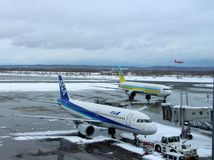 Planes landing at getting ready at Chitose airport on a snowy day Sapporo Stock Image