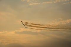 Planes on orange sky. Royalty Free Stock Photo