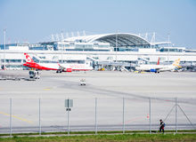 Planes in parking position at Munich ariport. MUNICH, GERMANY - APRIL 9: Planes in parking position at the the airport of Munich, Germany on April 9, 2017. The stock photo