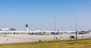 Planes in parking position at Munich ariport. MUNICH, GERMANY - APRIL 9: Planes in parking position at the the airport of Munich, Germany on April 9, 2017. The stock photos