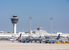 Planes in parking position at Munich ariport. MUNICH, GERMANY - APRIL 9: Planes in parking position at the the airport of Munich, Germany on April 9, 2017. The royalty free stock images