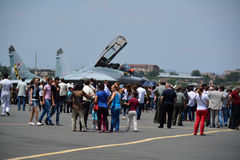 Planes and people. People looking into the plane in Armenia, Erebuni airport 11.06.2014 Royalty Free Stock Photography