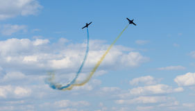 Planes performing colorful trails Royalty Free Stock Photos