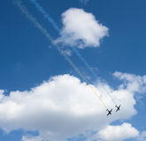 Planes performing colorful trails Royalty Free Stock Photo