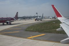 Planes are queuing on the tarmac before take off at Ho Chi Minh City airport, Vietnam stock images