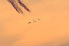 Planes silhouette on orange sky. Royalty Free Stock Photos