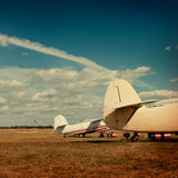 Planes stand in the autumn field. Royalty Free Stock Photo
