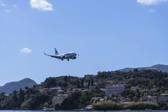 Planes taking off or landing at Kanoni,over the church of Panagia Vlacherna and the Mouse Island on the Greek Island of Corfu. Stock Image