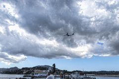 Planes taking off or landing at Kanoni,over the church of Panagia Vlacherna and the Mouse Island on the Greek Island of Corfu. Royalty Free Stock Image