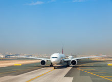 Planes on taxiway Stock Photos