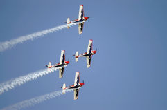 Planes teams. Team of four planes show smoke Royalty Free Stock Image